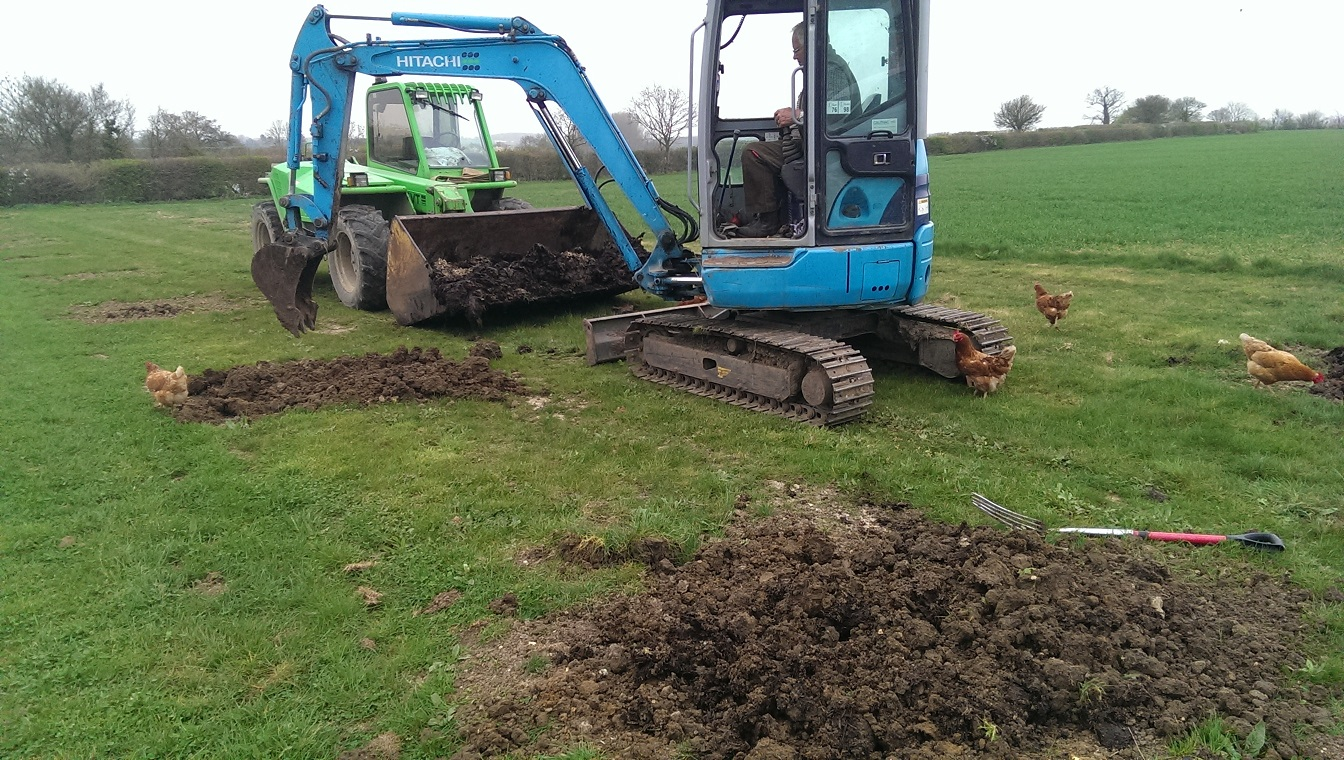 Digging-Muck-into-Holes-2